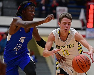 CANTON, OHIO - MARCH 12, 2019: Bristol's Mick Wiebe dribbles while being pressured by Richmond Heights' Bj Carter during the second half of their game, Tuesday night at the Canton. Richmond Heights won 66-34. DAVID DERMER | THE VINDICATOR