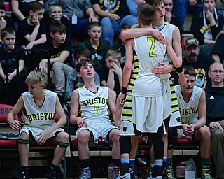 CANTON, OHIO - MARCH 12, 2019: Bristol's Matt Church, back, hugs Gage Elza during the second half of their game, Tuesday night at the Canton. Richmond Heights won 66-34. DAVID DERMER | THE VINDICATOR
