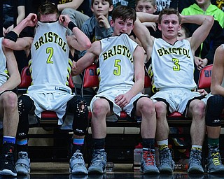 CANTON, OHIO - MARCH 12, 2019: (LtoR) Bristol's Gage Elza, Matt Stephens and Damion Durst sit on the bench after being removed from the game during the second half of their game, Tuesday night at the Canton. Richmond Heights won 66-34. DAVID DERMER | THE VINDICATOR