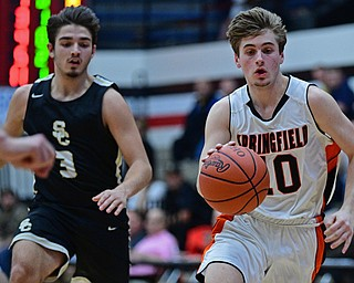 CANTON, OHIO - MARCH 12, 2019: Springfield's Clay Medvec dribbles ahead of South Central's Alex Holland during the second half of their game, Tuesday night at the Canton Fieldhouse. DAVID DERMER | THE VINDICATOR