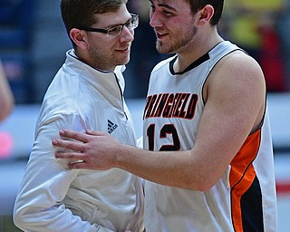 CANTON, OHIO - MARCH 12, 2019: Springfield's Shane Eynon is congratulated by head coach Steve French after being removed from the game during the second half of their game, Tuesday night at the Canton Fieldhouse. DAVID DERMER | THE VINDICATOR