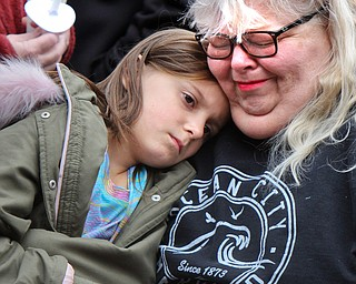 William D. Lewis The Vindicator Brenda Tenney, of Mineral Ridge and grandmother of Campbell boy killed in car crash consoles her niece Allison Lowe, 7, during a vigil Sunday 3-24-19 at Roosevelt Park  in Campbell.