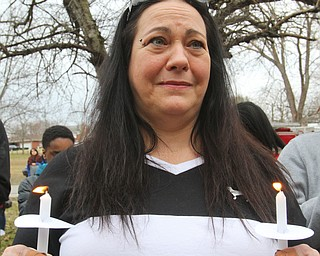William D. Lewis The Vindicator  Tina Mumfor, sister in law of a man killed in a Campbell car crash holds acandles during a 3-24-129 vigil at Roosevelt Park.