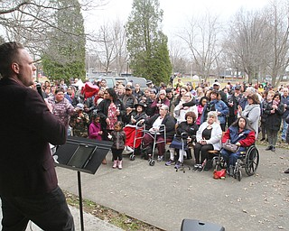 William D. Lewis The Vindicator  Chris Russo of Victory Christian Assembly church speaks during a vigil 3-24-19 at Roosevelt Parl in Campbell for a father and son who were killed in a car crash. More than 200 people attended the event.