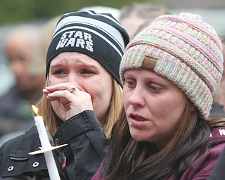 William D. Lewis The Vindicator More than 200 people attended a 3-24-19 vigil in Roosevelt Park, Campbell for a father and son who were killed in a car crash.