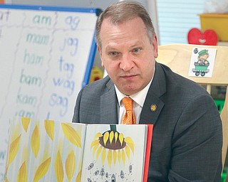 State Rep. Don Manning of New Middletown, R-59th, reads a children's book to Austintown Elementary School kindergartners in Tammy Deeley's classroom Monday morning. Manning met earlier that day with school officials on access to mental and behavioral health services.