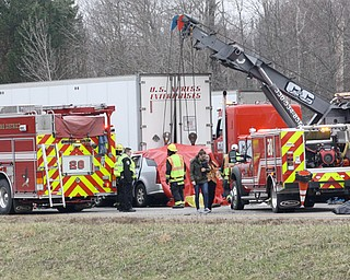 Fire, rescue and wrecker crews work Monday morning to clear the scene of a crash on Interstate 80 in Hubbard Township. The Ohio State Highway Patrol is not identifying the victim of the fatal crash, but says the person struck the rear of a stopped tractor trailer in the westbound lanes. The patrol says the tractor trailer driver was stopped because of an earlier crash on 80 between the Hubbard and Liberty exits.