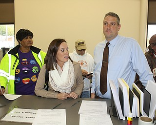 Oct. 28, 2016: U.S. Rep. Tim Ryan of Howland, answers a question while standing with his wife, Andrea, at the Trumbull County Board of Elections in Warren Monday. They were filling out the paperwork required before voting a paper ballot. Tim Ryan, Andrea Ryan and Ohio Sen. Capri Cafaro of Hubbard voted in person on the first day that voting hours were extended an hour in the evening to 8 a.m. to 6 p.m.  Ryan said he wants everyone to vote early. Another voter among the dozens who were at the elections board at noon was Heidi Scanlon of Niles.
