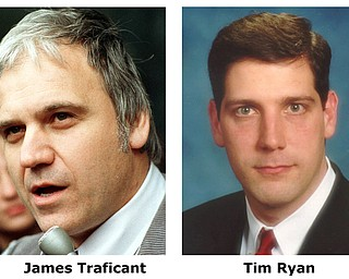** FILE ** Democrat Tim Ryan, center, and Republican Ann Womer Benjamin, right, are running for the Congressional seat of James Traficant, an independent, who was expelled after being convicted of bribery, racketeering and tax evasion. He is serving an eight-year sentence at a Pennsylvania prison. For use with Ohio Voters Guide. (AP Photo/File, handouts)