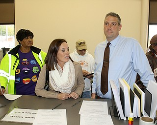 """U.S. Rep. Tim Ryan of Howland, answers a question while standing with his wife, Andrea, at the Trumbull County Board of Elections in Warren Monday. They were filling out the paperwork required before voting a paper ballot. Tim Ryan, Andrea Ryan and Ohio Sen. Capri Cafaro of Hubbard voted in person on the first day that voting hours were extended an hour in the evening to 8 a.m. to 6 p.m.  Ryan said he wants everyone to vote early. Regarding the presidential election and his views on Hillary Clinton being elected, he said, """"I think the last few weeks will be strong as long as we get out the vote. Another voter among the dozens who were at the elections board at noon was Heidi Scanlon of Niles, who said this election is different from ones in the past in that Donald Trump is in it. """"He's a TV personality, not a public official."""" She said she's excited at the prospect of having Hillary Clinton become the first woman president. """"We are very good leaders,"""" she said. """"We lead our households. I'm excited to see what this woman [Hillary] can do."""