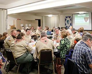 Scouts, leaders, and their family members eat dinner at the Whispering Pines Recognition Dinner in St. James Episcopal Church in Boardman on Sunday. EMILY MATTHEWS   THE VINDICATOR