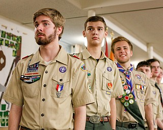 From left, Eagle Scouts Thomas McNally, of troop 25, Philip Hockensmith, of troop 44, and Colin Russell, of troop 60, stand with other Eagle Scouts to be recognized at the Whispering Pines Recognition Dinner in St. James Episcopal Church in Boardman on Sunday. EMILY MATTHEWS   THE VINDICATOR