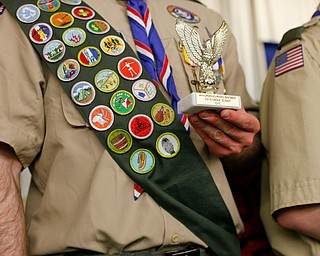 Eagle Scout Colin Russell, of troop 60, holds his award after being recognized with other Eagle Scouts at the Whispering Pines Recognition Dinner in St. James Episcopal Church in Boardman on Sunday. EMILY MATTHEWS   THE VINDICATOR