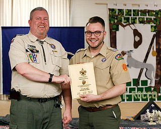 John Brkic, right, District Director, presents Jason Henry, of pack 25 in Canfield, with the Cubmaster of the Year award at the Whispering Pines Recognition Dinner in St. James Episcopal Church in Boardman on Sunday. EMILY MATTHEWS   THE VINDICATOR