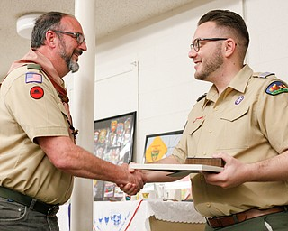 Albin Dearing, left, shakes hands with District Director John Brkic as he's presented with the District Award of Merit at the Whispering Pines Recognition Dinner in St. James Episcopal Church in Boardman on Sunday. EMILY MATTHEWS   THE VINDICATOR