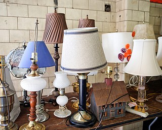 Lamps are among the many items that will be for sale in the furniture room at the Angels for Animals garage sale that is taking place Friday through Sunday at the Canfield Fairgrounds. EMILY MATTHEWS | THE VINDICATOR