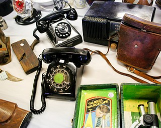 Many antique items, including telephones and microscopes, will be for sale in the antique room at the Angels for Animals garage sale that will be taking place Friday through Sunday at the Canfield Fairgrounds. EMILY MATTHEWS | THE VINDICATOR