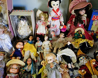 Dolls are among the many items that will be for sale in the antique room at the Angels for Animals garage sale that will be taking place Friday through Sunday at the Canfield Fairgrounds. EMILY MATTHEWS | THE VINDICATOR