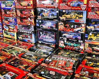 Replica miniature race cars are among the many items that will be for sale in the antique room at the Angels for Animals garage sale that will be taking place Friday through Sunday at the Canfield Fairgrounds. EMILY MATTHEWS | THE VINDICATOR