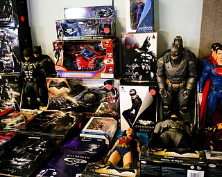 Superhero figurines are among the many items that will be for sale in the antique room at the Angels for Animals garage sale that will be taking place Friday through Sunday at the Canfield Fairgrounds. EMILY MATTHEWS | THE VINDICATOR