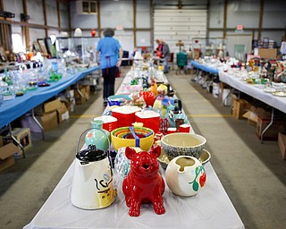 Colorful kitchenware are among the many items that will be for sale in the antique room at the Angels for Animals garage sale that will be taking place Friday through Sunday at the Canfield Fairgrounds. EMILY MATTHEWS | THE VINDICATOR