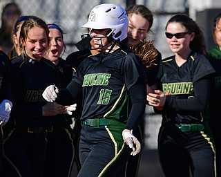 YOUNGSTOWN, OHIO - APRIL 9, 2019: Ursuline's Emily Holland is congratulated by her teammates after hitting a solo home run in the second inning of Tuesday afternoons game at Youngstown State Softball Complex. DAVID DERMER | THE VINDICATOR