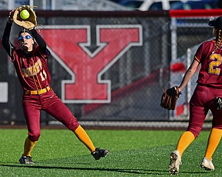 YOUNGSTOWN, OHIO - APRIL 9, 2019: Mooney's Lexi Diaz fields the ball after a RBI-single by Ursuline's Destiny Goodnight in the third inning of Tuesday afternoons game at Youngstown State Softball Complex. DAVID DERMER | THE VINDICATOR