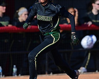 YOUNGSTOWN, OHIO - APRIL 9, 2019: Ursuline's Destiny Goodnight scores a run after a RBI-double by Gia Caldrone in the third inning of Tuesday afternoons game at Youngstown State Softball Complex. DAVID DERMER | THE VINDICATOR