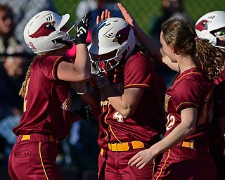 YOUNGSTOWN, OHIO - APRIL 9, 2019: Mooney's Catie Perry, center, is congratulated by her tames Brooke Chandler, right, and Gia DiFabio, left, after hitting a solo home run in the fourth inning of Tuesday afternoons game at Youngstown State Softball Complex. DAVID DERMER | THE VINDICATOR