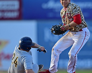 NILES, OHIO - APRIL 10, 2019: Youngstown State's Phillip Glasser looks to first after forcing out Toledo's Trace Hatfield at second base in the sixth inning of Wednesday nights game at Eastwood Field. Youngstown State won 5-3. DAVID DERMER | THE VINDICATOR
