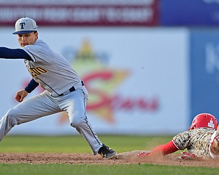 NILES, OHIO - APRIL 10, 2019: Youngstown State's Lucas Nasonti steals second base beating the tag from Toledo's Thomas Eitniear in the seventh inning of Wednesday nights game at Eastwood Field. Youngstown State won 5-3. DAVID DERMER | THE VINDICATOR