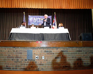 The shadows of crowd members are outlined as Sen. Bernie Sanders speaks during the union town hall at Lordstown High School Sunday afternoon. EMILY MATTHEWS | THE VINDICATOR