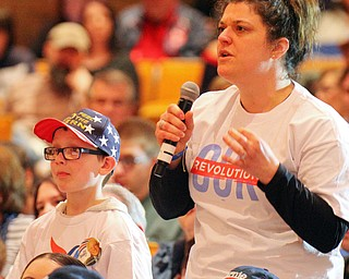 William D. Lewis The Vindicator   Katie Fallo and her son Ben DeLong, 8, ask a question during a 4-14-19 Sanders rally at Lordstwn HS. They are from Niles she is an educator and her ex husband is a former GM employee at Lordstown.