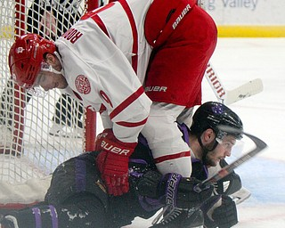 William D. Lewis The Vindicator Phantoms Daltn Messina(14) and ) moves the puck past Dubuque's Luke Robinson(9) get tangled up during 4-15-19 action in Youngstown.
