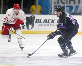 William D. Lewis The Vindicator Phantoms Brett Murray(21) moves the puck past Dubuque's Cooper Haar(15) during 4-15-19 action in Youngstown.