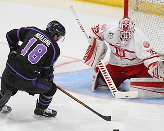William D. Lewis The Vindicator Phantoms Jack Malone (18)lines up a shot  Dubuque's Matthew Thiessen (35) during 4-15-19 action in Youngstown.