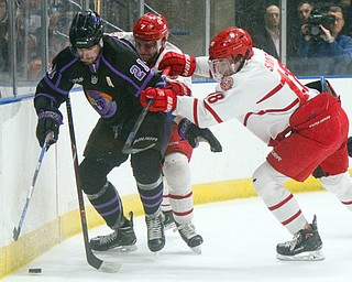 William D. Lewis The Vindicator Phantoms Brett Murray(21) keeps  the puck fromDubuque's Jacob Semik(7) and Patrick Smyth(18) during 4-15-19 action in Youngstown.
