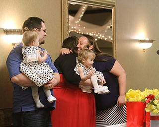 ROBERT K.YOSAY    THE VINDICATOR..Trumbull Children Services Rising up - Moving On to honor those who have overcome problems in their life or stepped up to help children.at  CimineroÕs Banquet Hall in Niles..Kristen Trumbull and Justin Bishop with Alicia and Tatiana - twin 1 year olds....Jessica Watkins presented the award