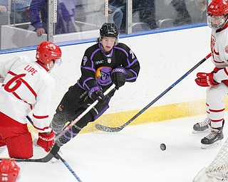 William D. Lewis The vindicator PhantomTristan Amonte(7) goes for the puck between Dubuque's Chris Lipe(6) and Patrick Smyth(18)) blocks a shot during 4-16-19 playoff game .