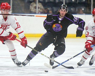 William D. Lewis The Vindicator Phantoms Joey Abate(45) moves the puck between Dubuque'sVerners Egle(11) and Logan Pietla(11) during 4-16-19 playoff game.