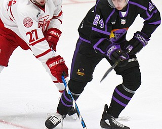 William D. Lewis The Vindicator Phantoms Steve Holtz924) and Dubuque's Willie Knierim(27)  during 4-16-19 playoff game.