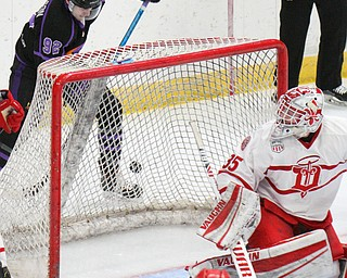 William D. Lewis The Vindicator Phantoms Liam Robertson(92) moves the puck around Dubuque goalie Matthew Thiessen(35) during 4-16-19 playoff game.