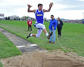COLUMBIANA, OHIO - APRIL 16, 2019: Southern Local's Jayce Sloan competes during the boys long jump, Tuesday afternoon at Columbiana High School. DAVID DERMER | THE VINDICATOR