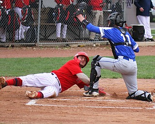 William D. Lewis The Vindicator Niles' Nick Guarnieri(7) is out at home during 1rst inning of 4-1719 game at Niles. making the tag for Poland is Andrew Testa(11).