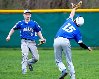 William D. Lewis The Vindicator Poland's Mason McCurdy(15) hauls in  a flyball while Alex Barth(2) cover during  a game 4-17-19 at Niles.