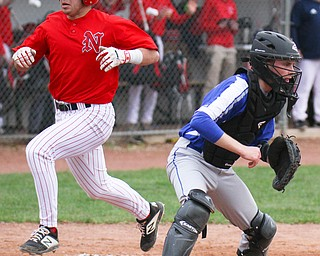 William D. Lewis The Vindicator Niles' Joe Gallo(17) scores during 1rst inning of 4-17-19 game at Niles.Wfor the throw is Poland's Andrew Testa(11).