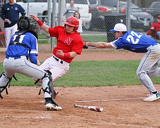 William D. Lewis The Vindicator Niles' Nick Guarnieri(7) is out at home during 4-17-19 game at Niles. making the tag for Poland is Braden Olsen(22) at the plate is Andrew Testa(11).