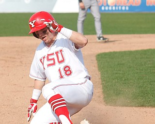 YSU's Drew Dickerson slides into third during their second game against NKU on Thursday. EMILY MATTHEWS | THE VINDICATOR