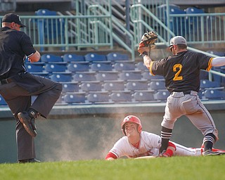 YSU's Lucas Nasonti gets called out at third after NKU's Andrew Bacon tags him out on a slide during their second game on Thursday. EMILY MATTHEWS | THE VINDICATOR