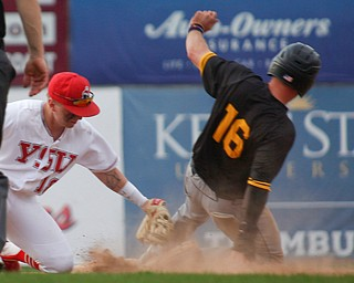 YSU's Drew Dickerson tags NKU's Will Haueter out at second during their second game on Thursday. EMILY MATTHEWS | THE VINDICATOR